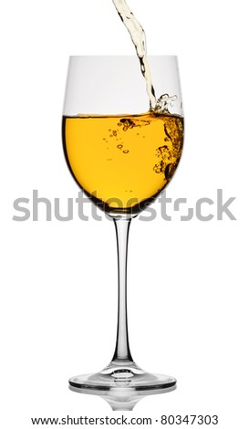White wine poured in a glass isolated on a white background