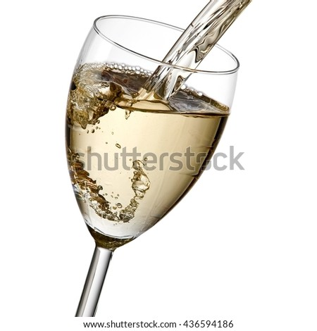 White wine pouring, close up - stock photo