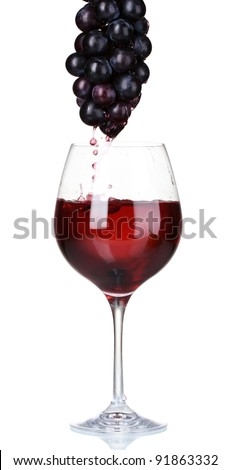 White wine pouring into glass and grapes isolated on white - stock photo