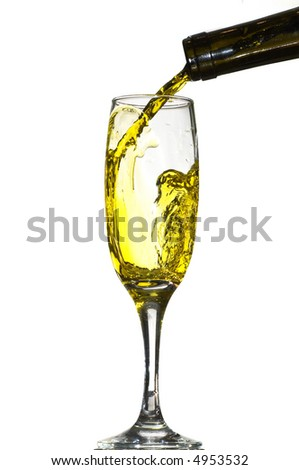 White wine pouring into glass isolated on white background