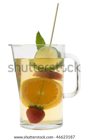 White wine sangria with fruit Sangria in a pitcher on a white background - stock photo