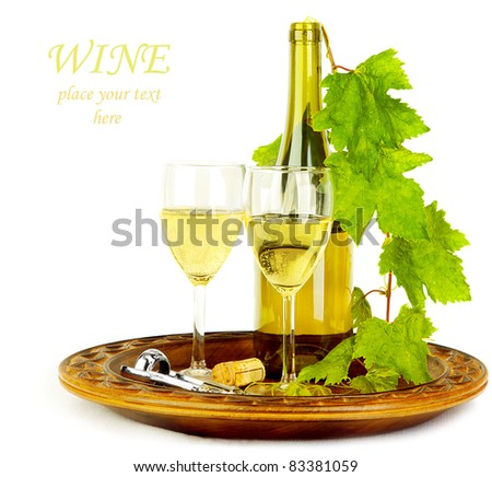 White wine still life, romantic setup for two, bottle with wineglasses and grape vine isolated on white background - stock photo