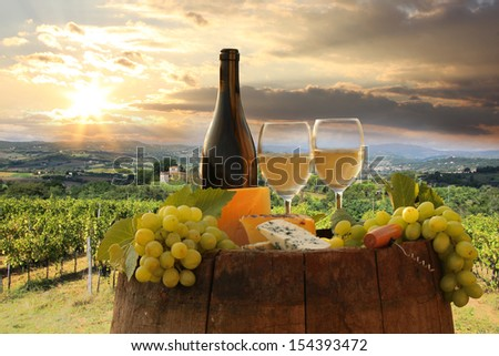 White wine with barrel on vineyard in Chianti, Tuscany, Italy