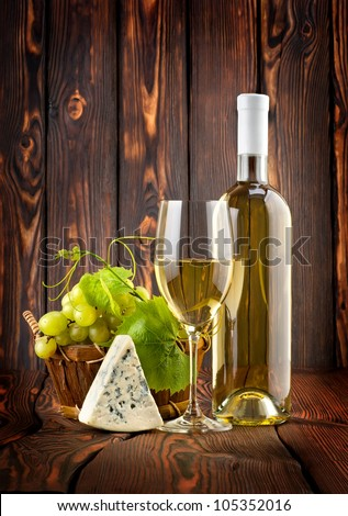 White wine with grapes and blue cheese - stock photo