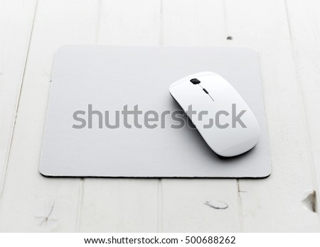 White wireless mouse on a mouse pad
