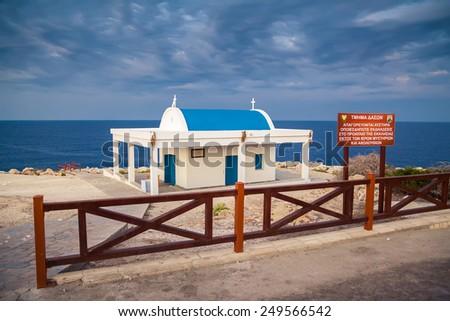 white with blue orthodox church Ag Anargyroi at Cape Greko near Ayia Napa, Cyprus - stock photo