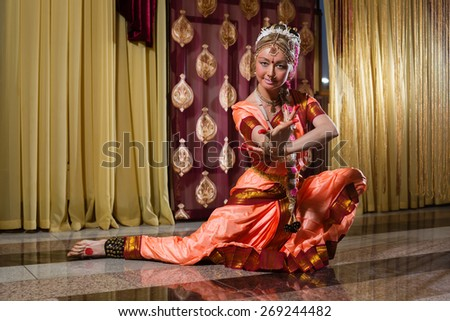 White woman is dancing in traditional indian dress - stock photo
