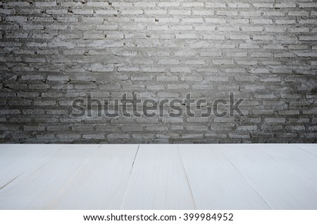 white wood table with modern stone wall background