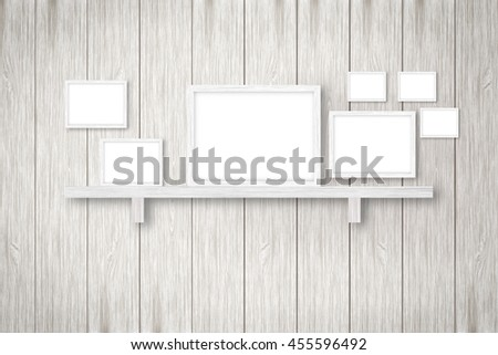 white wooden background with white frames, interior decoration