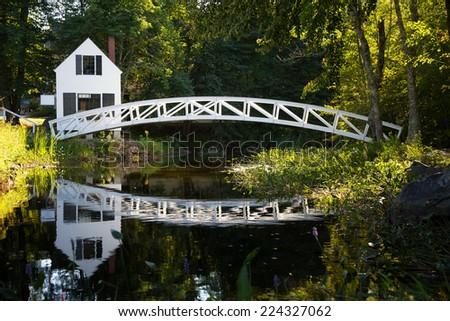 White wooden bridge reflected in a pond, Somesville, Mount Desert Island, Maine, USA - stock photo