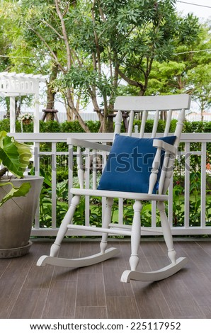 White Wooden Rocking Chair On Front Porch At Home