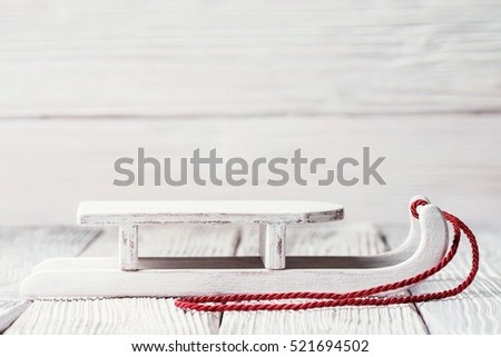 White wooden sledge with red cord, Christmas concept