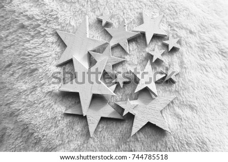 White wooden stars on a white cushion, selected focus, christmas motif