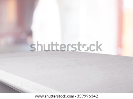 White wooden table on blurred interior background