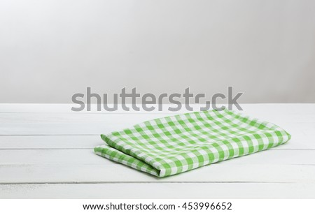 White wooden table with tablecloth, background for the product montage - stock photo