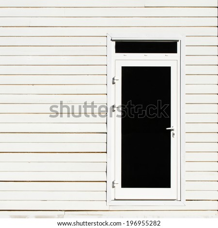 White wooden wall and door - stock photo