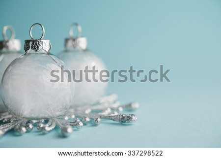 White xmas ornaments on light blue background. Merry christmas card. Winter holidays. Xmas theme. Space for text. Happy New Year. - stock photo