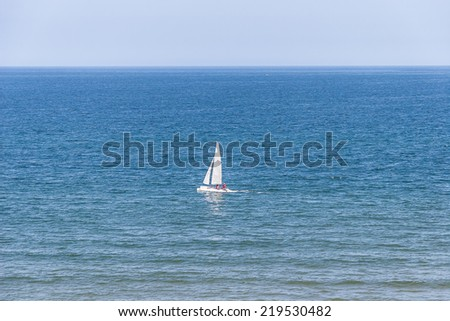 White Yacht at sea at summer time