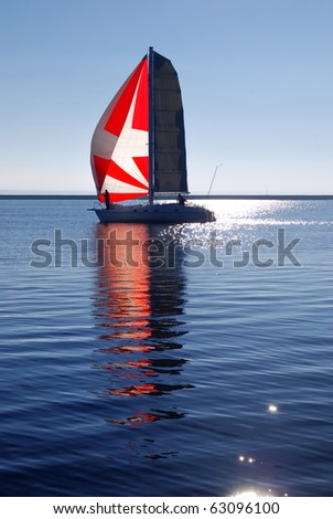 white yacht sailing in bright sunny day - stock photo