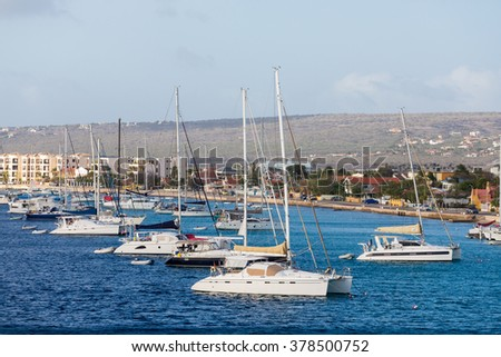 White yachts and sailboats moored off the coast of Bonaire