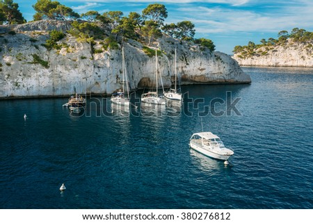 White Yachts boats in bay. Calanques - a deep bay surrounded by high cliffs in the azure coast of France - stock photo