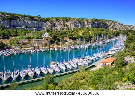 White yachts in Calanque de Port Miou, one of biggest fjords between Marseille and Cassis, France - stock photo
