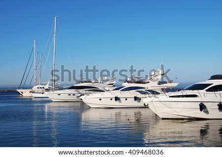 White yachts in the port - stock photo