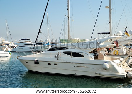 White yachts on an anchor in harbour - stock photo