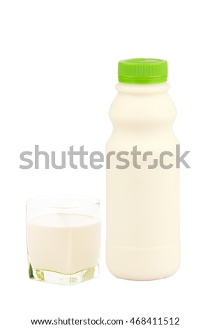 White Yogurt Milk Plastic Bottle with grass  isolated in white .