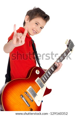 White young boy with a electric guitar shows the heavy metal gesture - isolated on white background