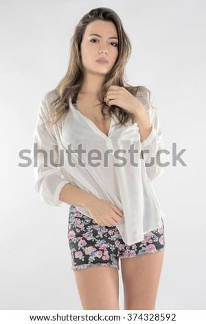 white young girl fashion model wearing white shirt short jeans - stock photo