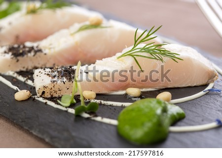 Whitefish fillet served on stone plate. Close up - stock photo