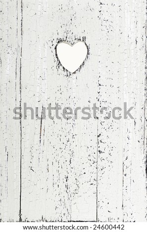 whitewashed grainy wood with heart cut out - stock photo