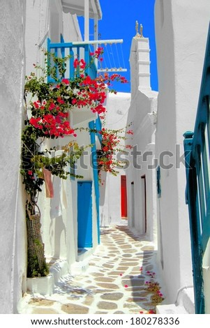 Whitewashed street in the old town of Mykonos, Greece  - stock photo
