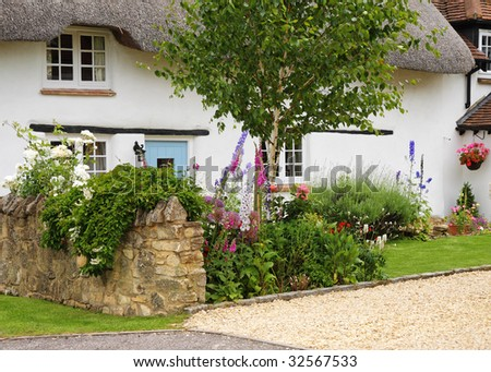 Whitewashed Thatched English Village Cottage and garden