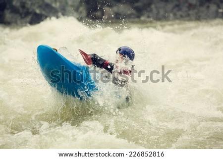 Whitewater kayaking through Boulder Drop on the Skykomish River in Washington State. - stock photo
