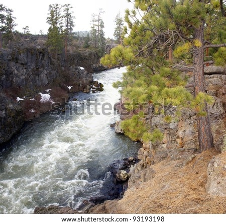 Whitewater rapids & waterfalls in rocky lava canyon,		Deschutes River,	Central Oregon - stock photo