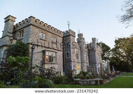 WHITSTABLE, KENT, ENGLAND - OCT 30, 2014. Whitstable Castle at dusk. It first started life as a residence for the Pearson Family in the late 1790's and is now open to the public.  - stock photo