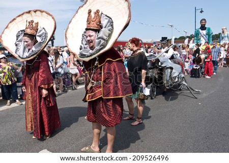 WHITSTABLE,UK-JULY 26: The Oyster King and Queen in costume take part in the Annual Oyster Festival Parade, watched by thousands of visitors. July 26, 2014 Whitstable UK. - stock photo