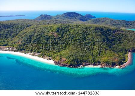 Whitsunday Island aerial with fringing reef - stock photo