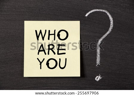 Who are you note with a big chalk question mark on blackboard. - stock photo