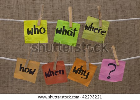 who, what, where, when, why, how questions - uncertainty, brainstorming or decision making concept, colorful crumpled sticky notes hanging on clothesline against canvas background - stock photo