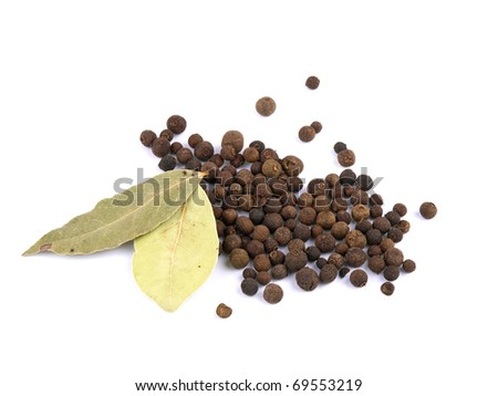 Whole allspice berries and two bay leafs on white background - stock photo