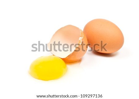whole and broken egg isolated on white background
