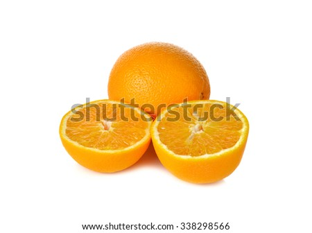 whole and cut ripe orange on white background - stock photo