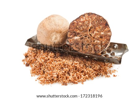 whole and grated nutmeg on white background - stock photo