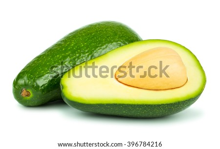 Whole and half avocado isolated on white background