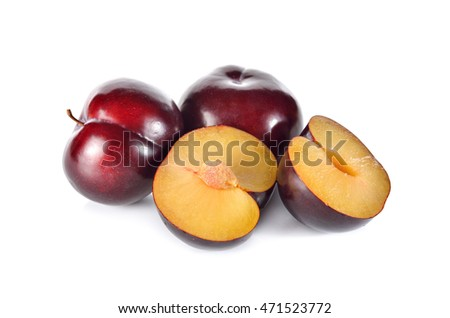 whole and half cut ripe plum on white background