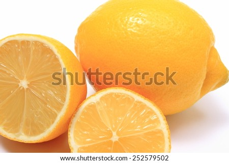 Whole and half of fresh lemons on white background, citrus, concept for healthy nutrition - stock photo