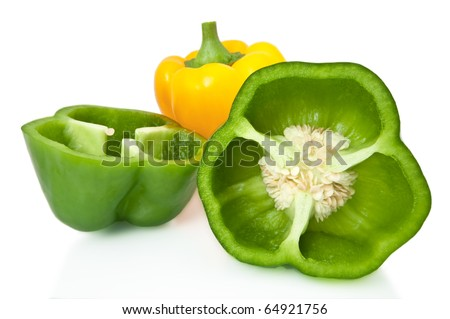 Whole and halved bell peppers arranged over white. - stock photo